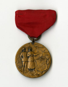 Cecil Burdick's WWI service medal, brass medal with red ribbon