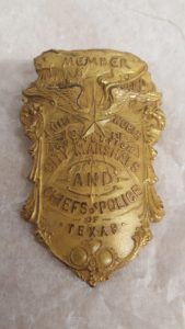 Floyd Burdick's gold colored badge from Ft Worth Texas Marshall and police chief's convention