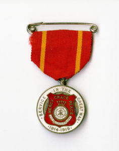 A service medal with red and yellow ribbon
