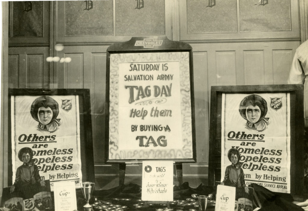 A display of three framed Doughnut Day posters from the 1930s arranged on a table.
