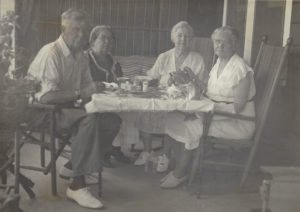 Four people seated at a table