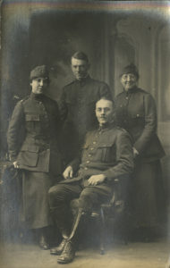 A family group featuring father, mother, son and daughter all wearing Salvation Army WWI uniforms