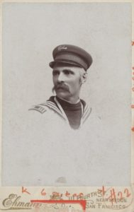Black and white photo of a man wearing sailor style clothing
