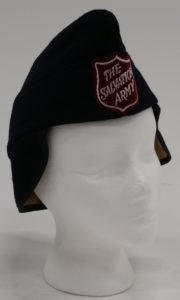 Soft fabric pointed hat with ear and neck flaps. The hat has a quilted lining. It also has a Salvaiton Army Red Shield logo patch on the front.