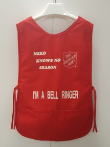 Red smock style bellringer fabric apron.