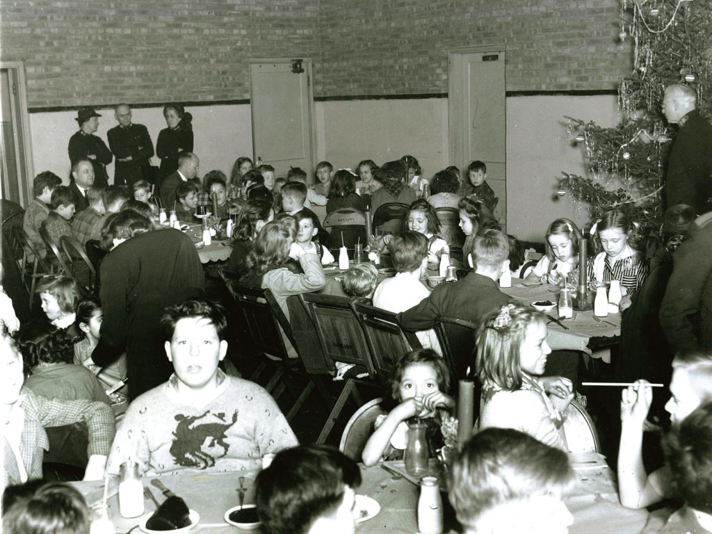 Black and white photograph showing a Christmas party for children