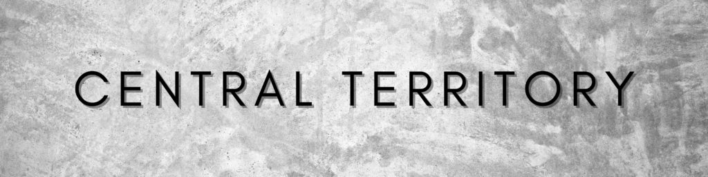 "Graphic containing grey textured background and text ""Central Territory"""