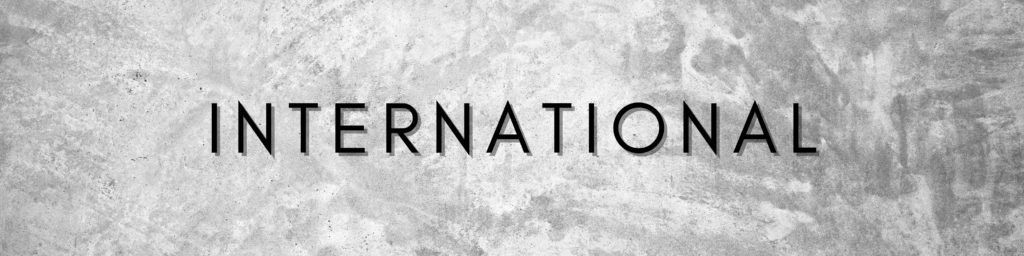 "Graphic containing grey textured background and text ""International"""
