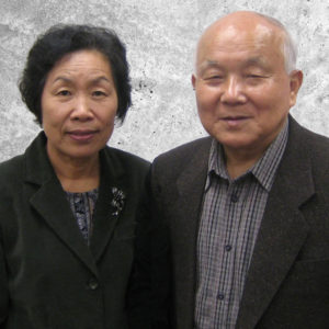Graphic button showing a photograph of Colonels Paul and Anna Kim