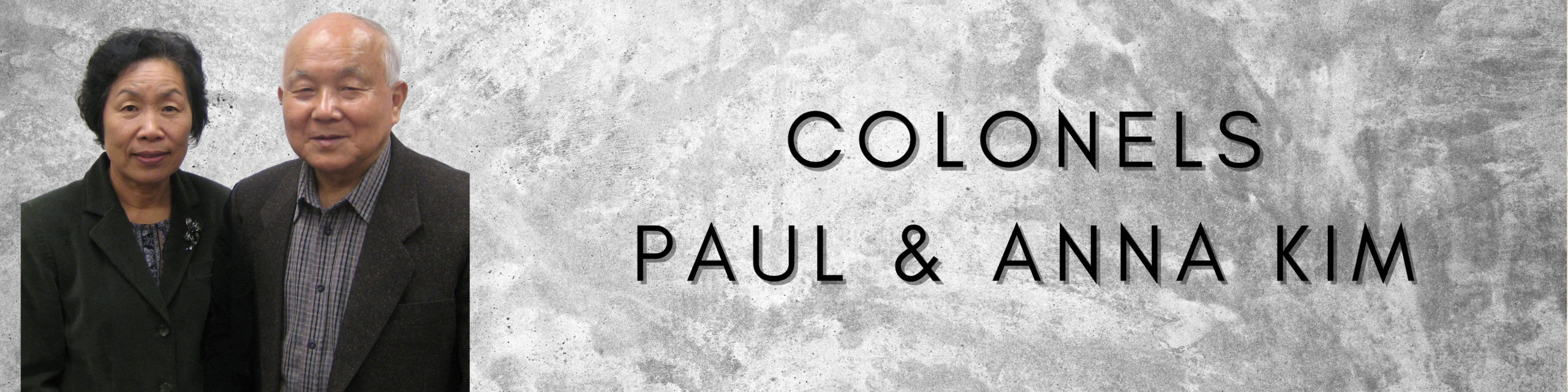 Page title graphic showing Colonels Paul and Anna Kim smiling and wearing street clothes.