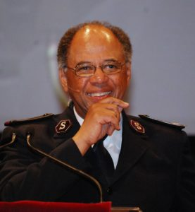 A man wearing a Salvation Army uniform, smiling