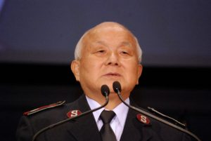 Photo of Colonel Paul Kim standing at a podium