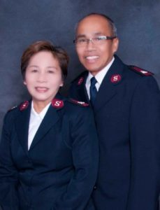 Photograph of the Majors Bruce and Betty Keobounhom wearing Salvation Army uniforms