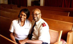 Photograph of Majors K. Kendall and Katrina Mathews seated in a chapel