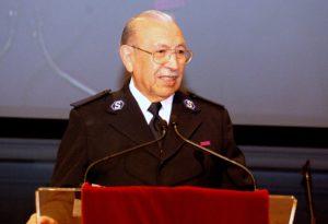Raul Guerrero speaking at a podium.