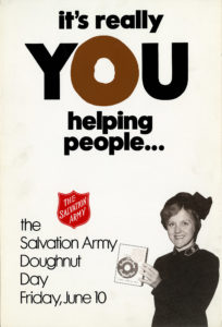 """A poster which features a photo of a female Salvation Army officer holding a paper Doughnut Day bank. Text reads: """"It's really you helping people ... The Salvation Army Doughnut Day Friday, June 10"""""""