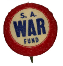 """Small round pin with white center and red outer rim. Text in center in blue reads """"S.A. War Fund."""""""